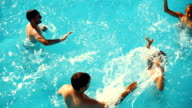 Two couples at swimming pool.