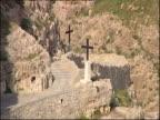 Two crosses line a stairway in the Wadi Qelt, Israel.