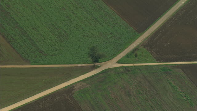 AERIAL WS ZO Two dirt roads crossing in middle of rural fields / Franche-Comte, France