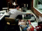 1978 Two DJs work on a recording in a radio studio