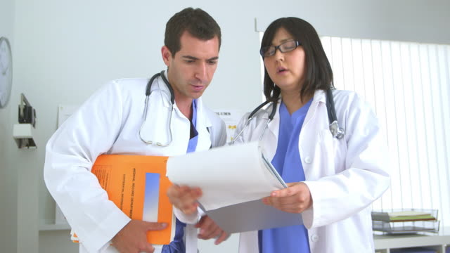 Two doctors reviewing test results