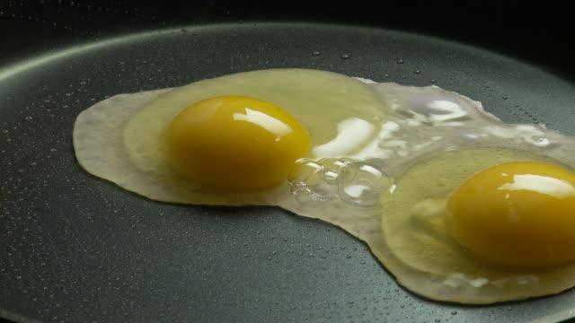 CU, Two eggs frying on pan, Atlanta, Georgia, USA