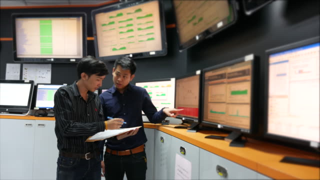 Two Engineer Checking in control room