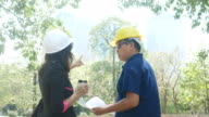Two environment engineers on construction site with plan