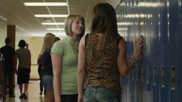 MS PAN Two female students (14-17) fighting in corridor / Spanish Fork City, Utah, USA
