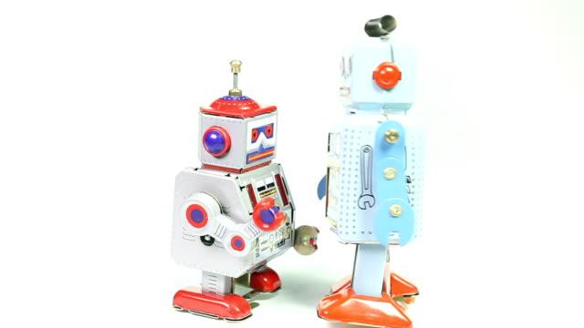 Two fighting retro tin toy robots