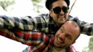 Two gay man having fun outdoors