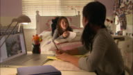 MS, Two girls (10-11) doing homework in bedroom