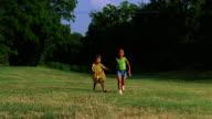 Two girls running hand in hand.