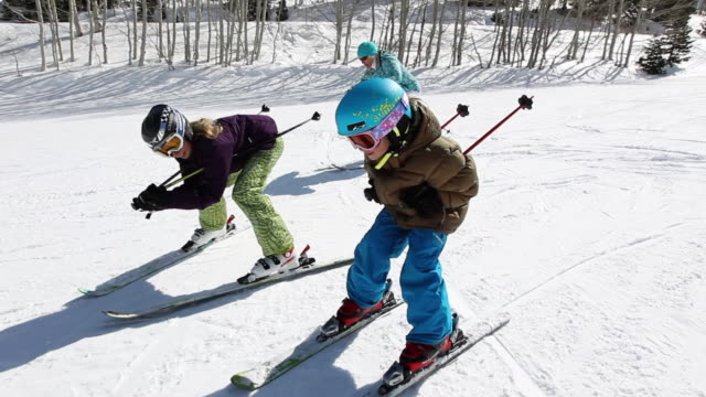 MS POV TS Two girls skiing with older woman (grandmother) / Park City, Utah, United States