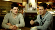 Two guys meeting up in a coffee shop