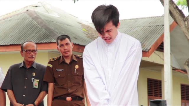 Two Indonesian men are caned in front of a jeering crowd as a punishment for gay sex in a first for the Muslim majority country where there is...