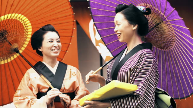 MS Two Japanese women in traditional clothes