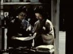 WS MS PAN Two Japanese women wearing kimonos look at silks, traditional decorative fans, hand-crafted bamboo vase, narrator discusses handicrafts as practical gifts / Kyoto, Japan / AUDIO