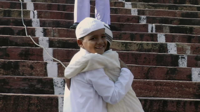MS Two kids hugging each other at steps of Jama Masjid / Delhi, India