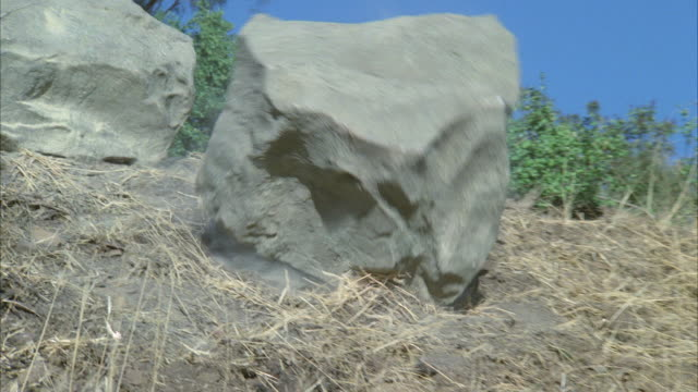 MS TD Two large boulders rolling down to road