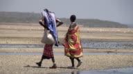 MS TS Two masai woman walking through dessert around lake magadii AUDIO / Magadi, Rift Valley, Kenya