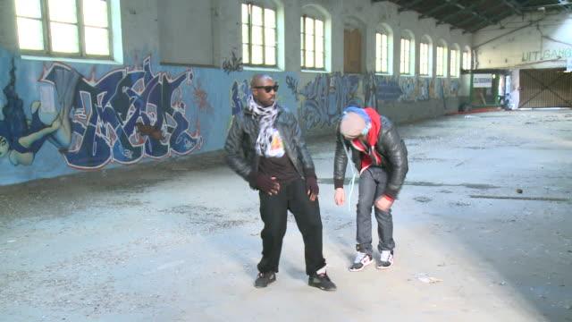 MS ZI two men dancing in warehouse, Gent, Belgium