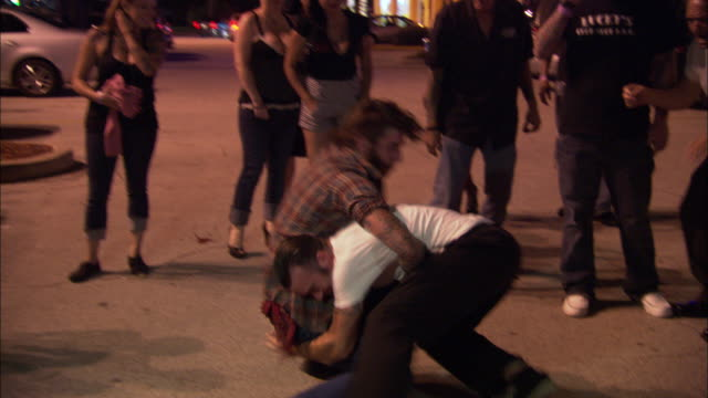 MS, SHAKY, Two men fighting on parking lot surrounded by watching people, Jacksonville, Florida, USA