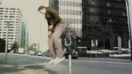 MS Two men jumping over parking meter, performing parkour, Vancouver, British Columbia, Canada