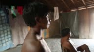 PAN CU Two men of the Kamayura tribe watch the Argentina v Netherlands FIFA 2014 World Cup game The Kamayura people are an indigenous tribe that...