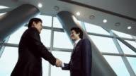 MS Two men shaking hand / Seoul, Seoul, South Korea