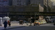 WS PAN POV Two men sitting in taxi  and taxi passing thorugh  road of yankee stadium / New York, New York, United States