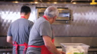 MS Two Men Sorting Ingredients in Commercial Kitchen / Richmond, Virginia, USA