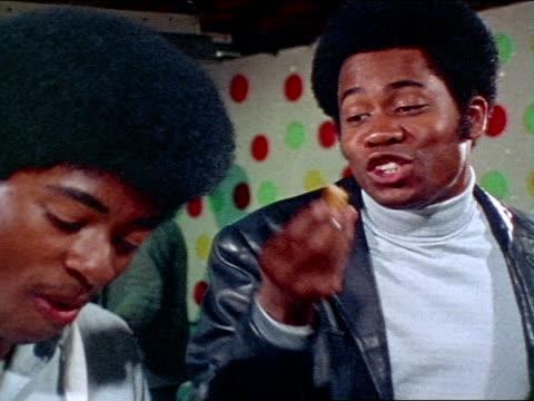 1971 MONTAGE Two men talking in nightclub / Los Angeles, California / AUDIO