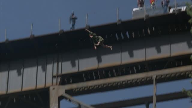 MS, PAN, LA, Two men throwing woman's body from railroad bridge into river