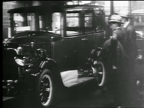 B/W 1927 two men watching car being tested in factory / New York State