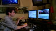 MS, ZI, CU, Two men working in recording studio