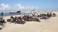 Two migrants trying to reach Europe by boat died off Libyas coast on Monday another 10 were missing and more than 100 rescued the coastguard said