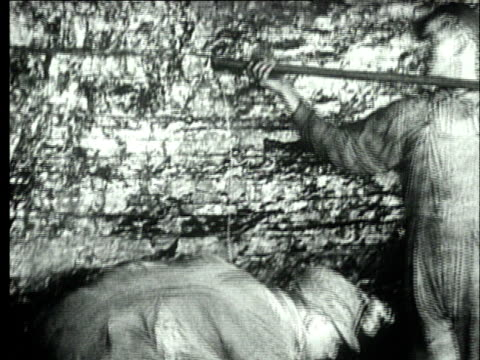 1927 B/W MS Two miners placing dynamite into coal face in underground bituminous coal mine/ Pennsylvania, USA