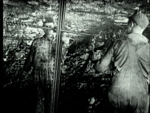 1927 B/W MS Two miners working underground with hand-operated device, drilling into coal face in bituminous coal mine/ Pennsylvania, USA