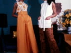 Two models pose wearing flared trousers and blouses designed by Clive of London 1968