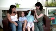 Two mothers and daughters playing