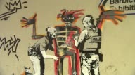 Two new Banksy artworks appear near the Barbican Centre ENGLAND London Barbican Centre EXT New artwork by Banksy on wall People looking at new Banksy...