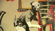 Two new Banksy artworks appear near the Barbican Centre Mural by Banksy on wall Estelle Lovatt interview with reporter in shot SOT Close shots of...