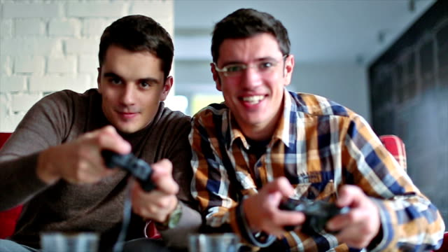 Two of friends playing video games