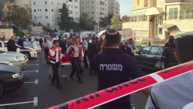 Two Palestinians armed with a gun and axes attacked a Jerusalem synagogue on Tuesday killing four Israelis police said