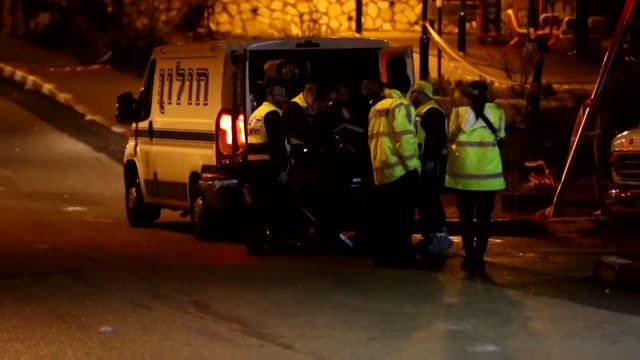 Two Palestinians stabbed two women Monday at a grocery in an Israeli settlement of the West Bank before being shot dead police and medics said in the...