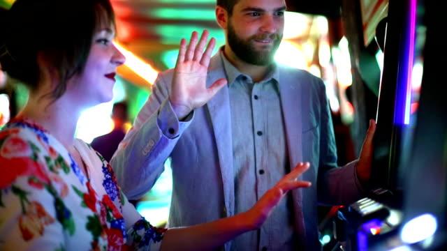 Two people having fun in casino.