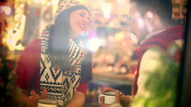 Two people having tea at cabin coffee shop.