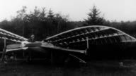 Two people in early airplane invention with flapping wings / plane collapses Early failed flight invention on January 01 1915 in Unspecified