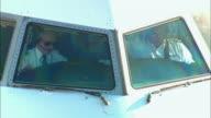 CU, Two pilots seen through aircraft cockpit windows, Los Angeles, California, USA