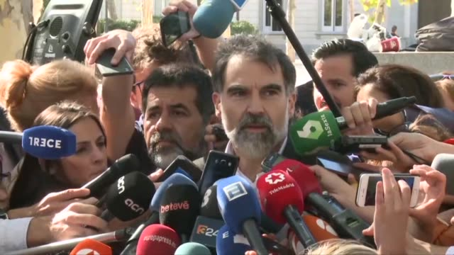 Two prominent Catalan separatist leaders made short statements after avoiding being remanded in custody at a court hearing Friday over sedition...