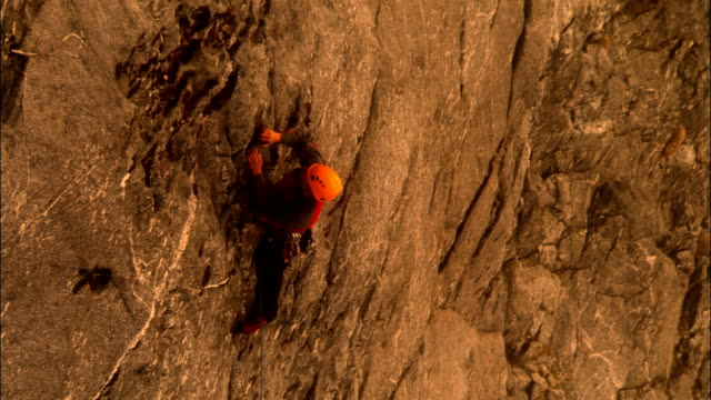 AERIAL, Two rock climbers on rock face, Fiordland National Park, New Zealand