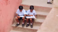 Two school students studying, Haryana, India