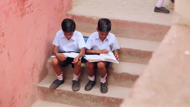 Two school students studying, Haryana, India
